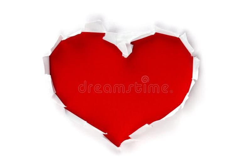 Foro di figura del cuore attraverso documento fotografia stock