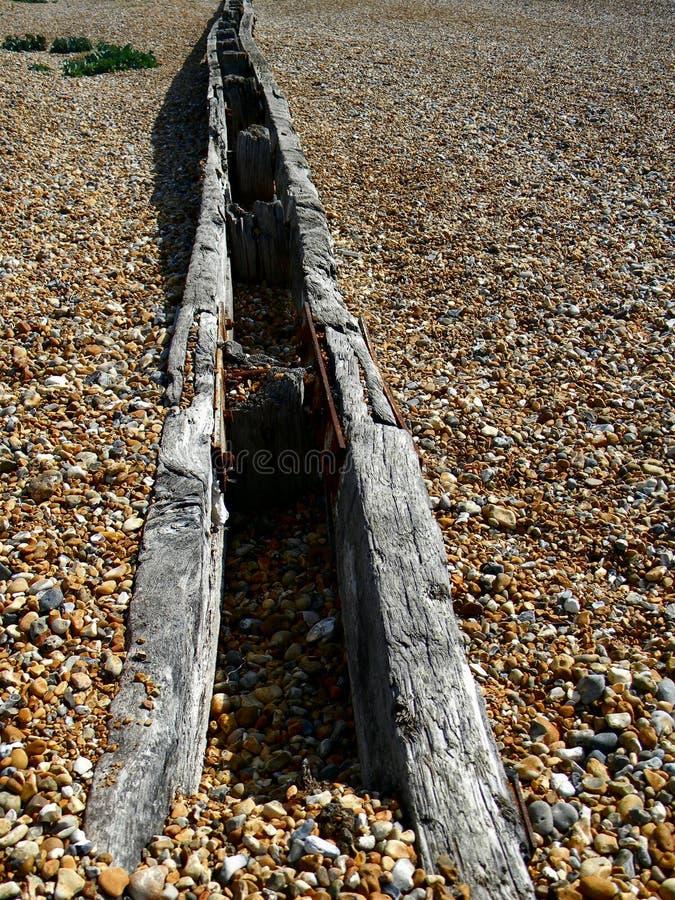 Foro di legno sepolto Pevensey Bay Sussex immagini stock