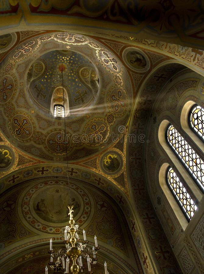 Foros, Ukraine, 02,08,2016 - a ray of light under the dome of an old Orthodox church near Foros, Crimea. Walls and dome in golden murals royalty free stock image