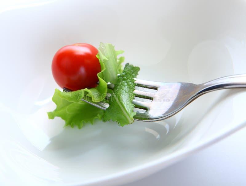 Forquilha com salada fotos de stock