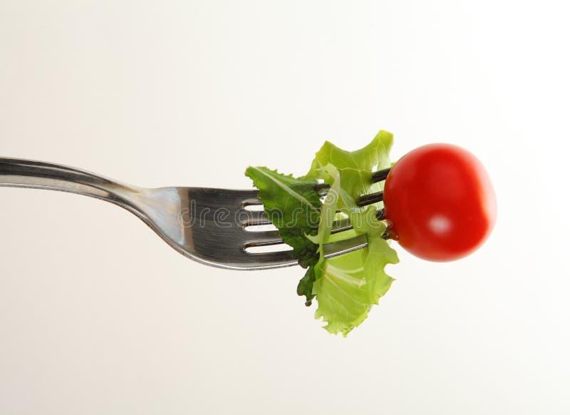 Forquilha com salada foto de stock