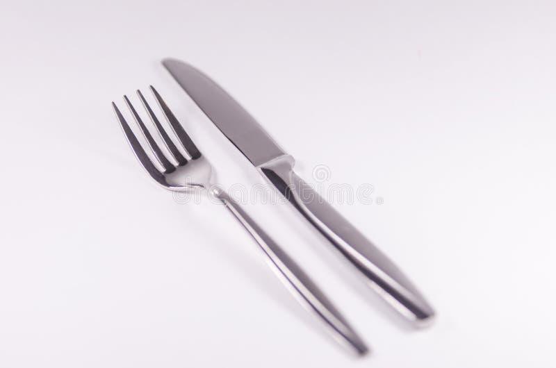 Forquilha de prata e knief isolados no fundo branco foto de stock royalty free