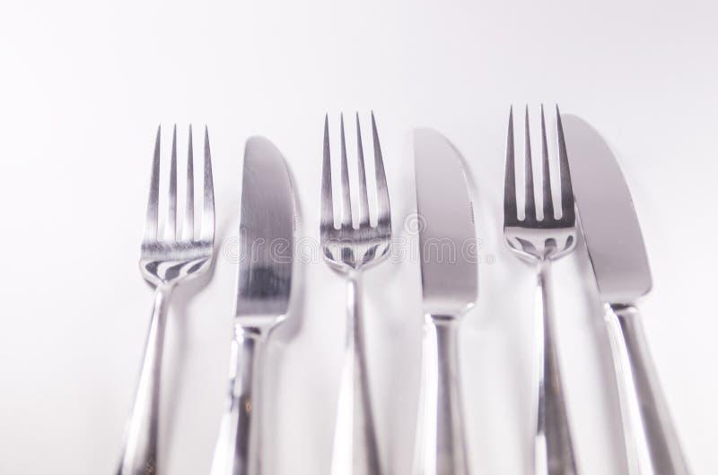 Forquilha de prata e knief isolados no fundo branco fotografia de stock