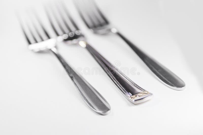 Forquilha de prata isolada no fundo branco imagem de stock royalty free