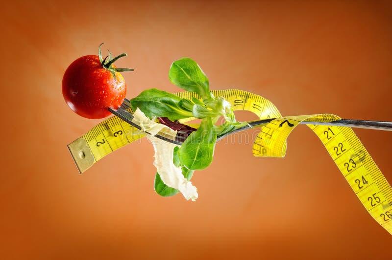 Forquilha, salada e metro, conceito nutritivo da dieta foto de stock royalty free