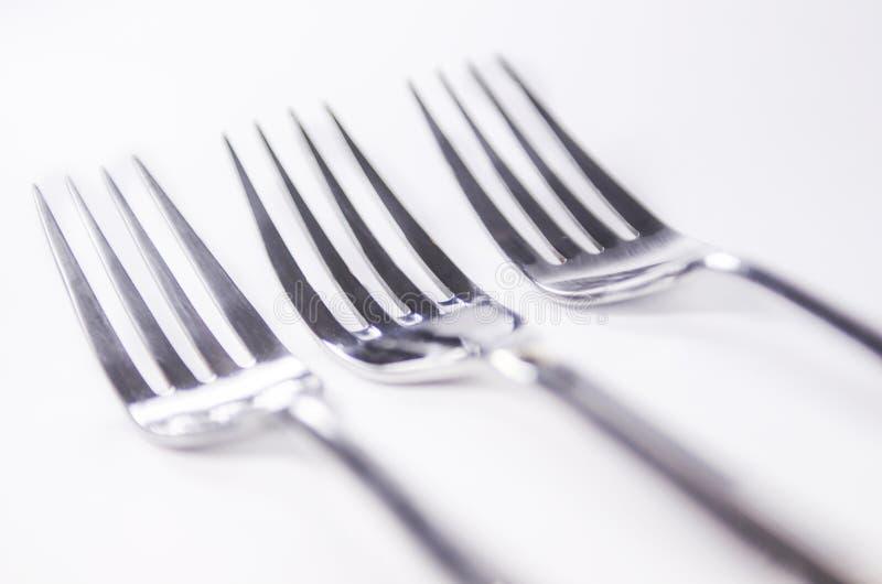 Forquilhas de prata isoladas no fundo branco imagem de stock royalty free