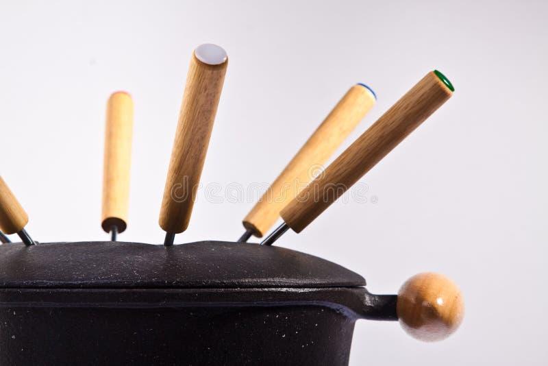 Forquilhas no fondue imagens de stock royalty free