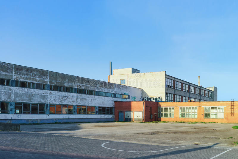 Forsaken factory in Ventspils in Latvia. Ventspils, Latvia - May 8, 2016: Forsaken factory in Ventspils in Latvia. It is a city in the Courland region of Latvia royalty free stock photo