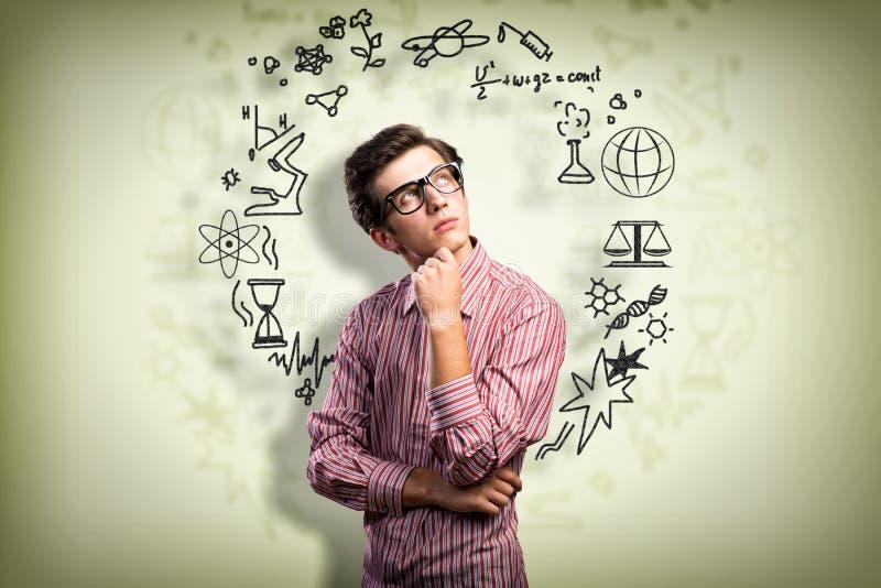 Forskare för ung man med att tänka för exponeringsglas arkivbild