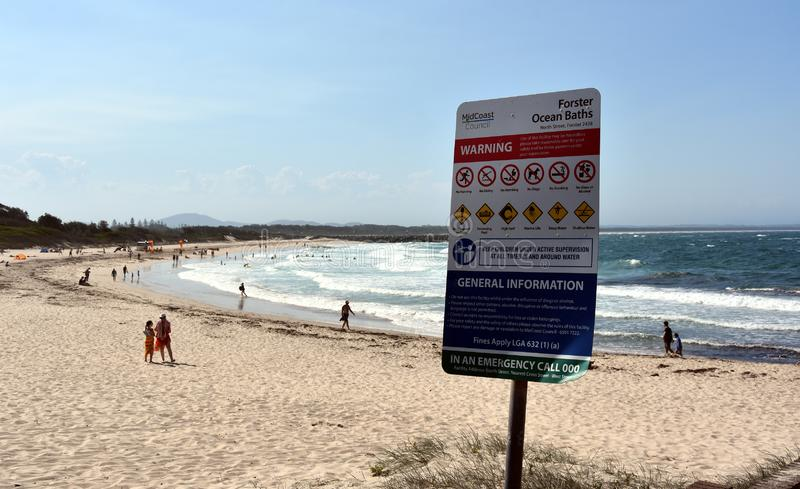 Warning signs at Forster beach. Forster, Australia - Jan 26, 2019. Warning signs at Forster beach to avoid hazardous dangerous accidents royalty free stock photography