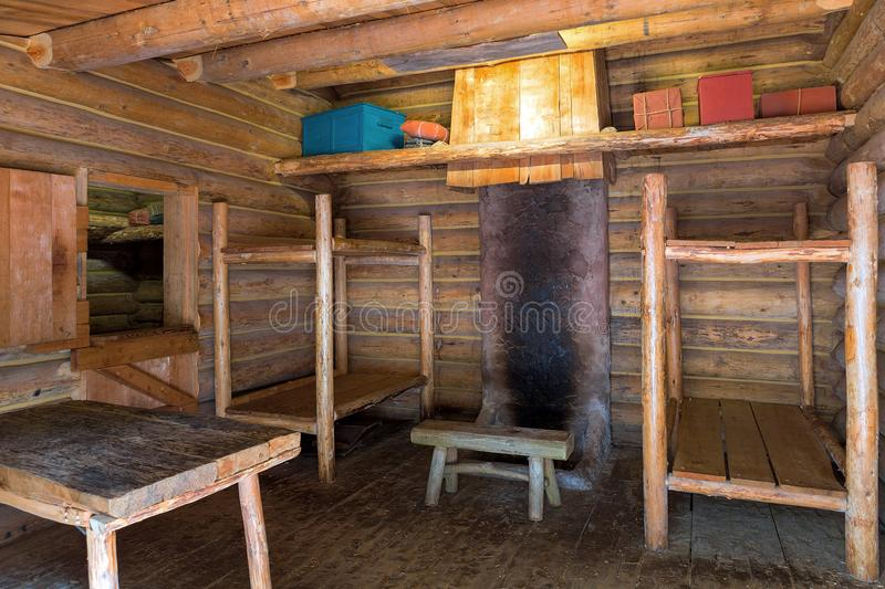 Fort Clatsop Living Quarters. Fort Clatsop Log Cabin living quarters with bunk beds table and chair in Lewis and Clark Historical National State Park stock image