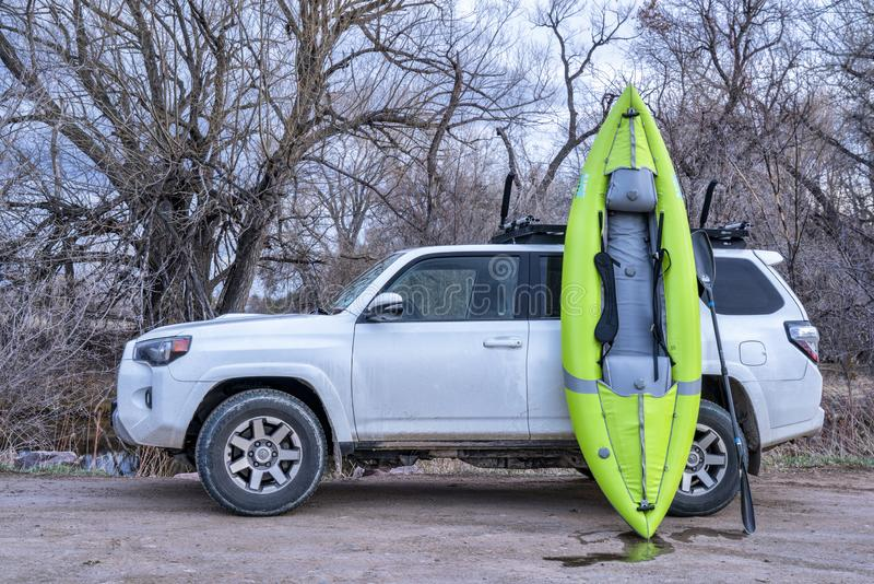 Toyota 4runner and whitewater inflatable kayak royalty free stock images