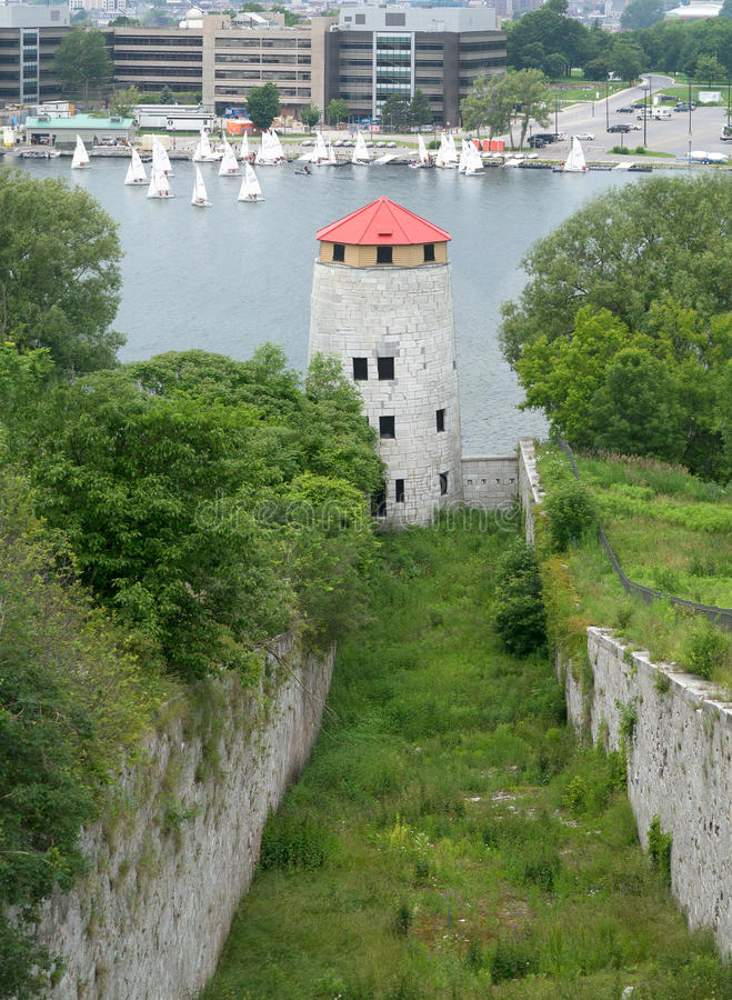 Fort Henry tower in Kingston, Ontario, Canada. One of the towers on the waterfront at Fort Henry in Kingston, Ontario, Canada with a view of the Royal Military royalty free stock photo