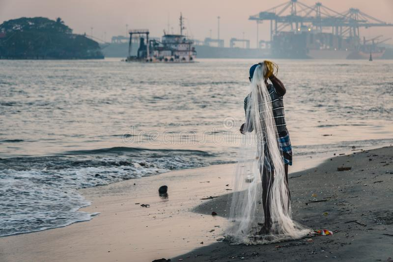 Fort Kochi fisherman work royalty free stock photography