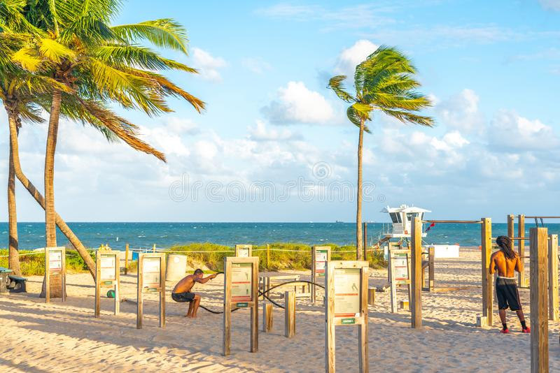 FORT LAUDERDALE, FLORIDA - September 20, 2019: People enjoying the beach gym at Fort Lauderdale in Florida on a sunny royalty free stock photo