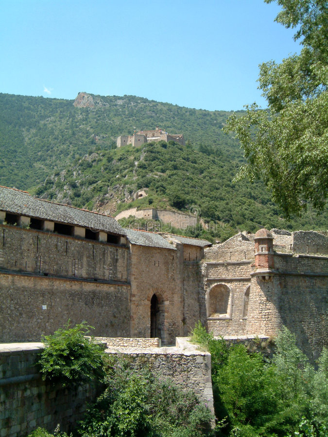 Fort Liberia. High above Villefrance-de-Conflent, The old walls of Villefrance in the forground royalty free stock photography