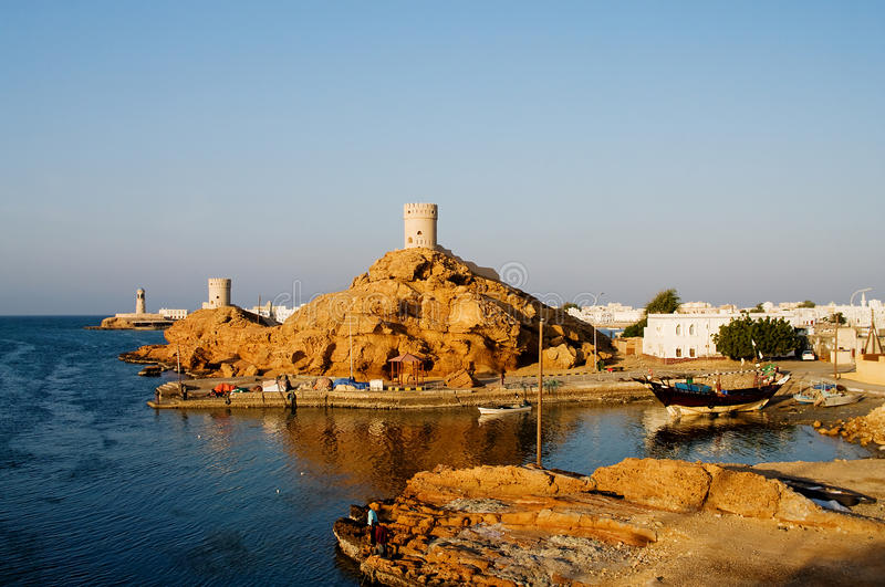 Fort and Lighthouse in Sur , Oman royalty free stock images