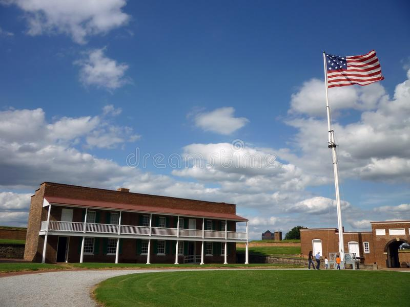 Fort McHenry Courtyard and Flag. Photo of the courtyard and the officer's quarters at fort mchenry in baltimore maryland. The american flag displays the stars of stock photography