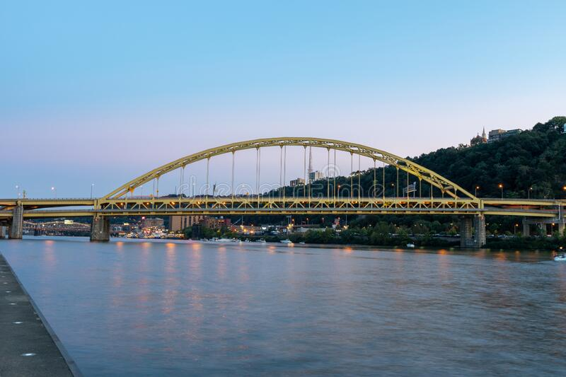 Fort Pitt Bridge and Monongahela River in Pittsburgh in Pennsylvania. Sunset Sky and Light royalty free stock photo