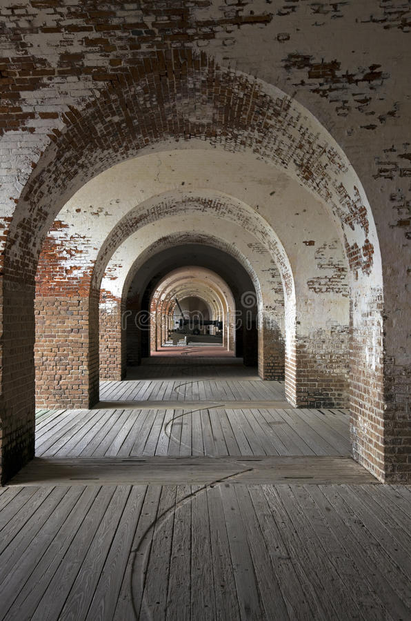 Fort Pulaski. In Georgia. Cannon seen at the end of arch corridor royalty free stock photo