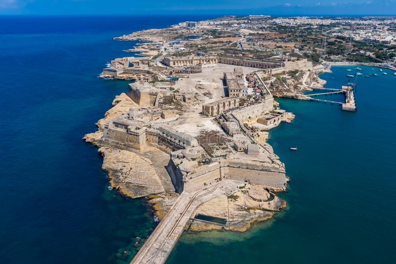 Fort Ricasoli aerial view. Island of Malta from above. Bastioned fort built by the Order of Saint John in Kalkara, Malta. Gallows` Point, north shore of royalty free stock image