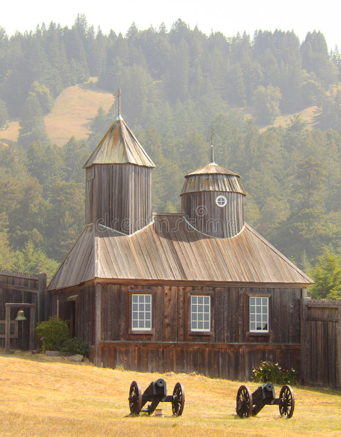 Fort Ross chapel and cannons. Fort Ross State Historic Park chapel and cannons stock image