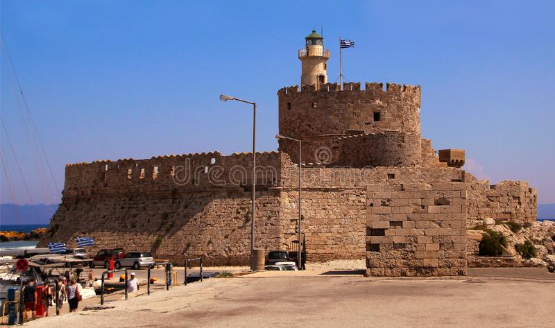 Fort of Saint Nicholas, Mandraki Harbour, Rhodes, Greece. Popular tourist  attraction royalty free stock photo