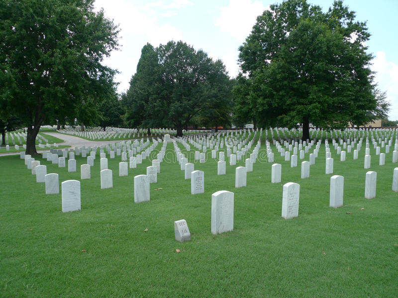Fort Smith National Cemetery gravestones. National Cemetery in Fort Smith, Arkansas white tombstones lined up on a beautiful green lawn royalty free stock photography