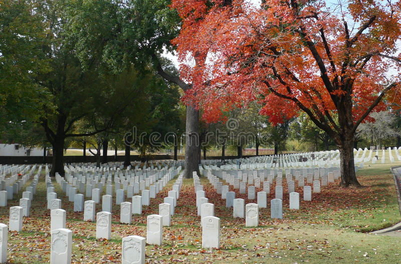 Fort Smith National Cemetery, November 2016. National Cemetery in Fort Smith, Arkansas white tombstones lined up, autumn colors royalty free stock image