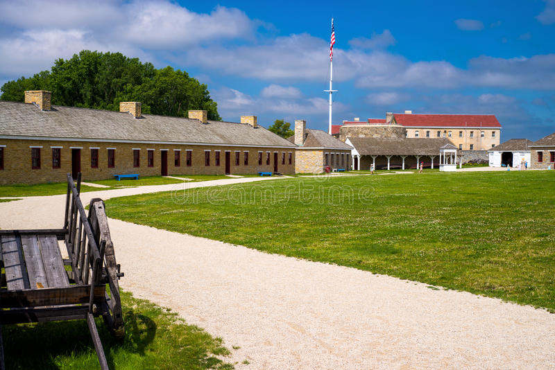 Fort snelling courtyard. Inside the walled fortification of historic fort snelling, costumed settlers reinact thier way of life from the middle 1800's, in royalty free stock photography