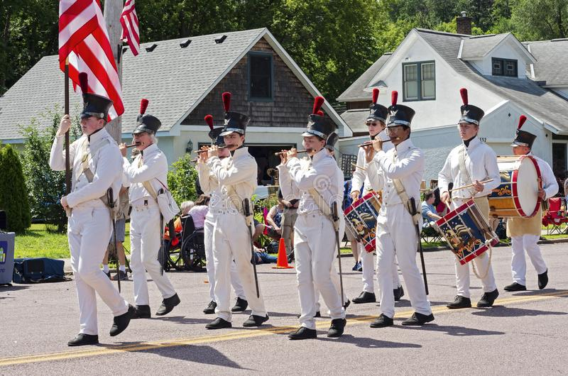 Fort Snelling Fifes and Drums at Mendota Parade. Mendota, MN/USA - July 13, 2019: Historic Fort Snelling fifes and drums corps marches in street at annual stock images