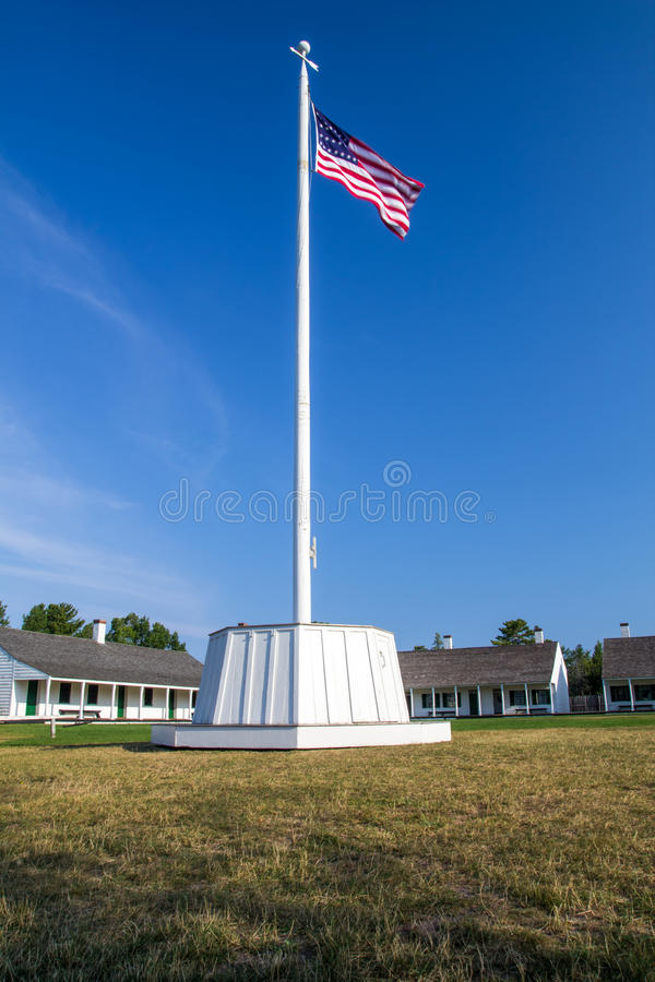 Fort Wilkins Historical Park. Copper Harbor, Michigan, USA - August 23, 2015. American Flag at Fort Wilkins in Northern Michigan. Fort Wilkins was established as stock photos