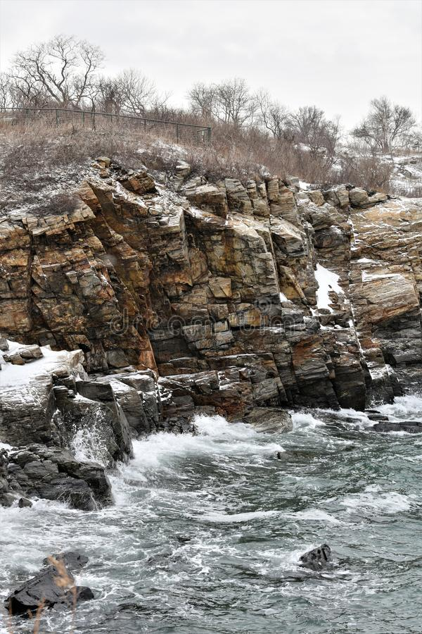 Fort Williams Park, Cape Eiizabeth, Cumberland County, Maine, United States New England US. Water view at Fort Williams Park on a cold cloudy blustery snowy royalty free stock image
