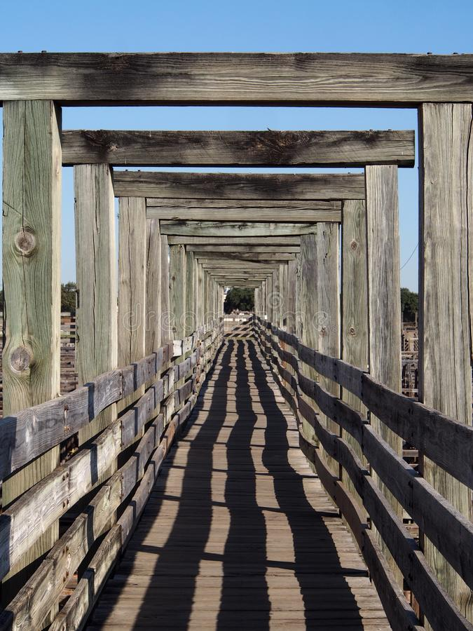Fort Worth Stockyards Walkway. A wooden walkway still travels over the pens of the old Fort Worth Stockyards stock photos