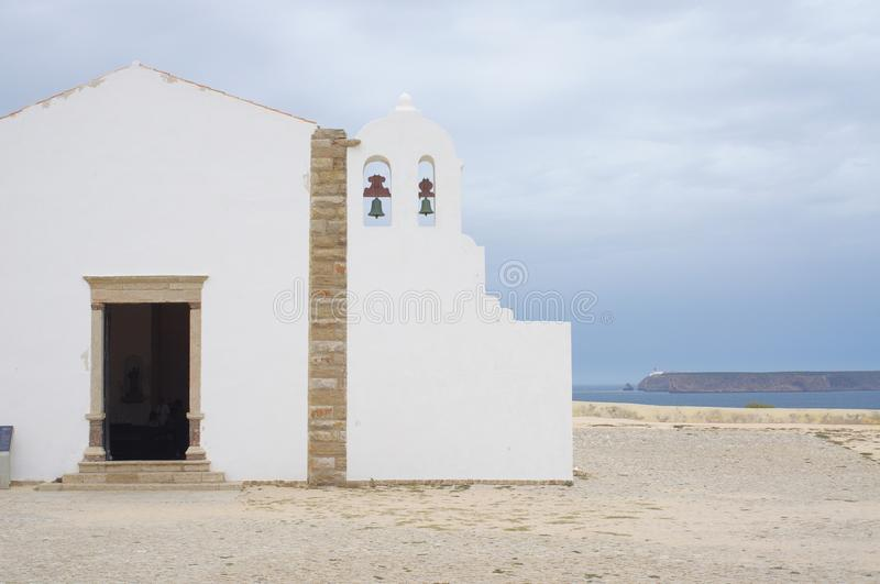 The Fortaleza Sagres in Sagres, Portugal. Little chapel at the Fortaleza Sagres in Sagres, Portugal with view to the Cabo de Vincent, the south westernmost point stock photo