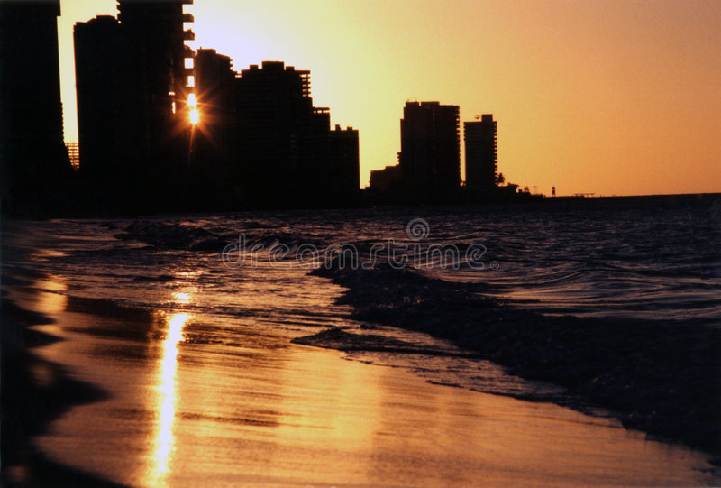 Fortaleza Sunset. Silhoettes of the skyscrapers as the sun sets along Meireles beach, Fortaleza, Ceará, Brasil royalty free stock photo