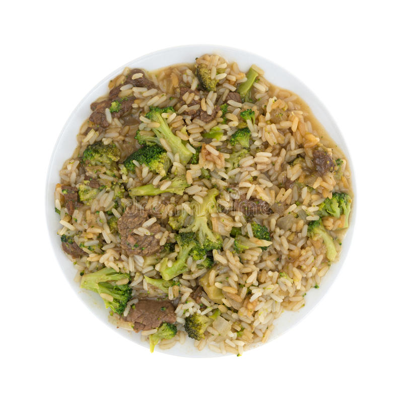 Fortalezca la cena del bróculi y del arroz en una placa foto de archivo