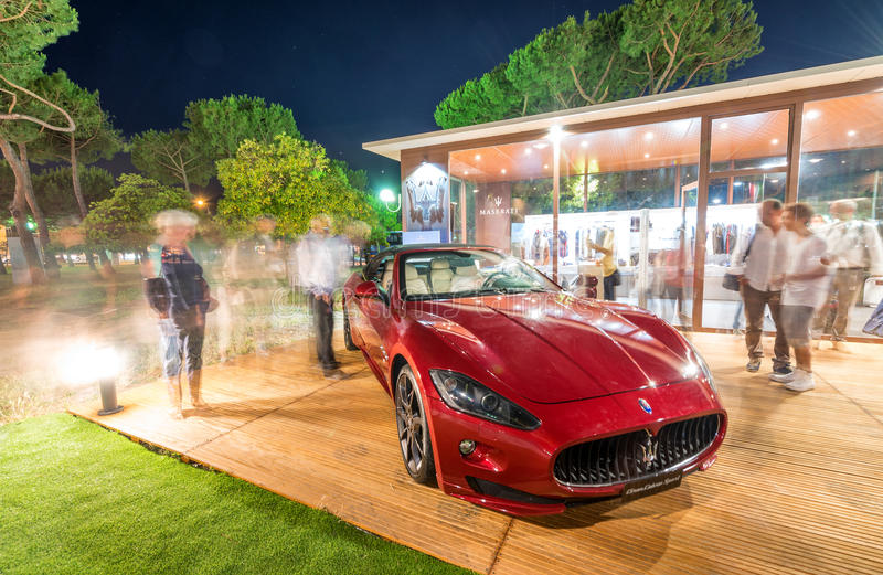 FORTE DEI MARMI, ITALY - JUNE 20, 2015: Tourists visit Maserati. Store in city center royalty free stock image