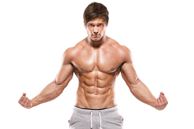 Forte uomo atletico che mostra ente muscolare fotografia stock