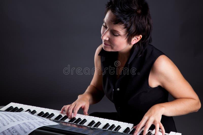 fortepianowa kobieta zdjęcia stock