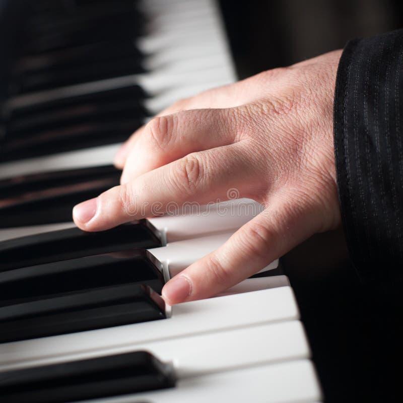 Fortepianowy bawić się obraz stock