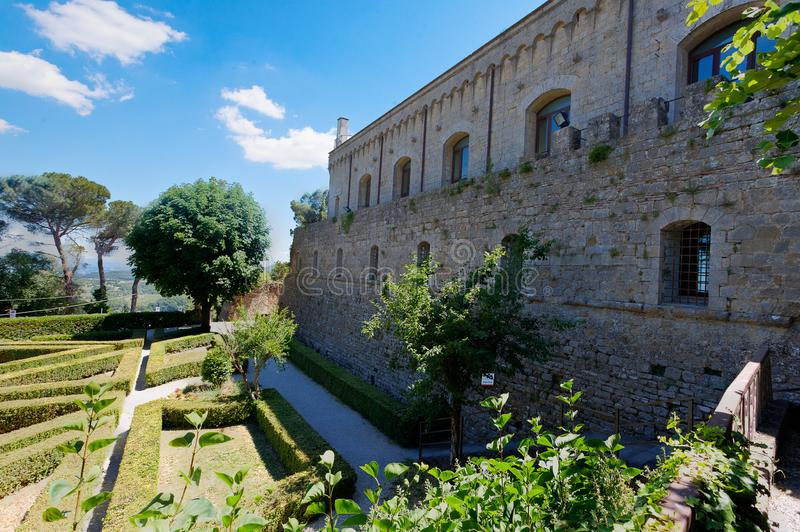 Fortezza Fortress of Montepulciano, Montepulciano, Tuscany, Italy. The Fortezza or Fortress of Montepulciano with garden and trees in the sun and under the blue stock images