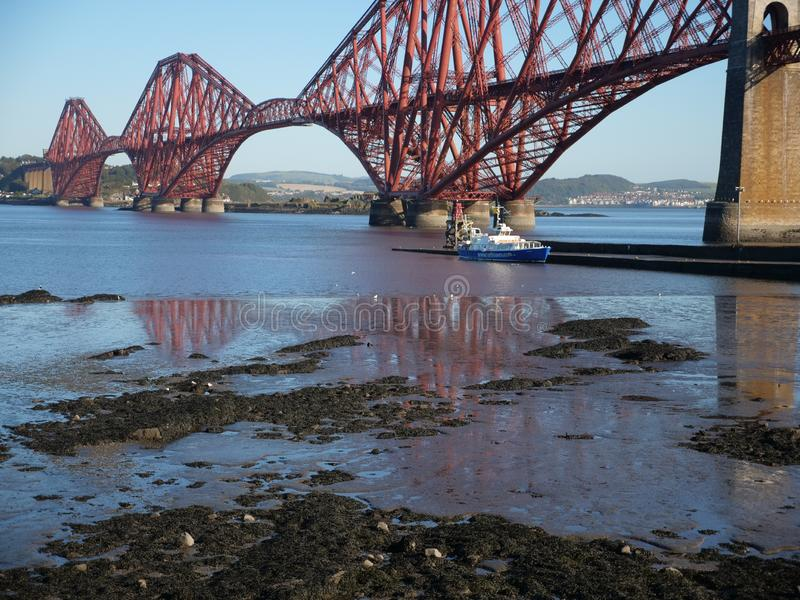 Forth Bridge Scotland Edinburgh. The Forth bridge in Scotland known for its over-engineered designed that was meant to provide confidence in the stability and royalty free stock images