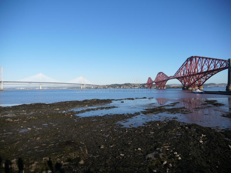 Forth Bridge Scotland Landscape. This landscape includes the Forth bridge in Scotland known for its over-engineered designed that was meant to provide confidence stock images