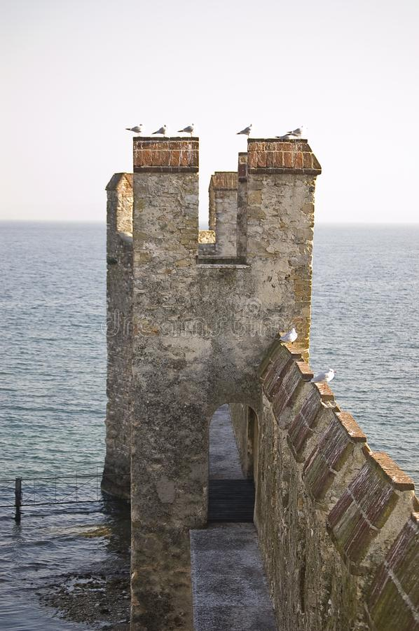 The fortification on the Garda`s lake, Lazise, Italy. The old fortification located on the Garda`s lake in Lazise, Italy royalty free stock photography