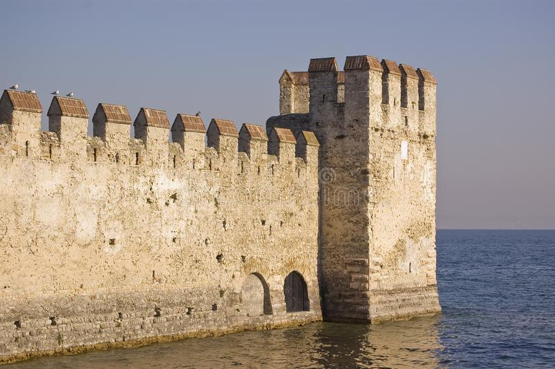 The fortification on the Garda`s lake, Lazise, Italy. The old fortification located on the Garda`s lake in Lazise, Italy stock image