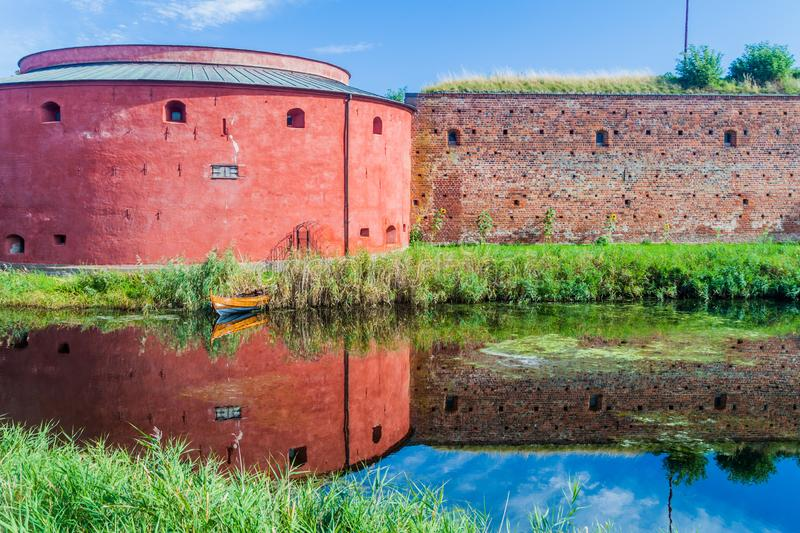 Fortification walls of Malmo Castle reflecting in its moat, Swed stock images