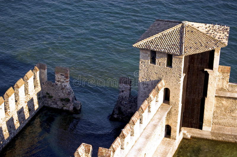 Fortification on the water. Fortification on the Garda's lake, Sirmione, Italy royalty free stock photos