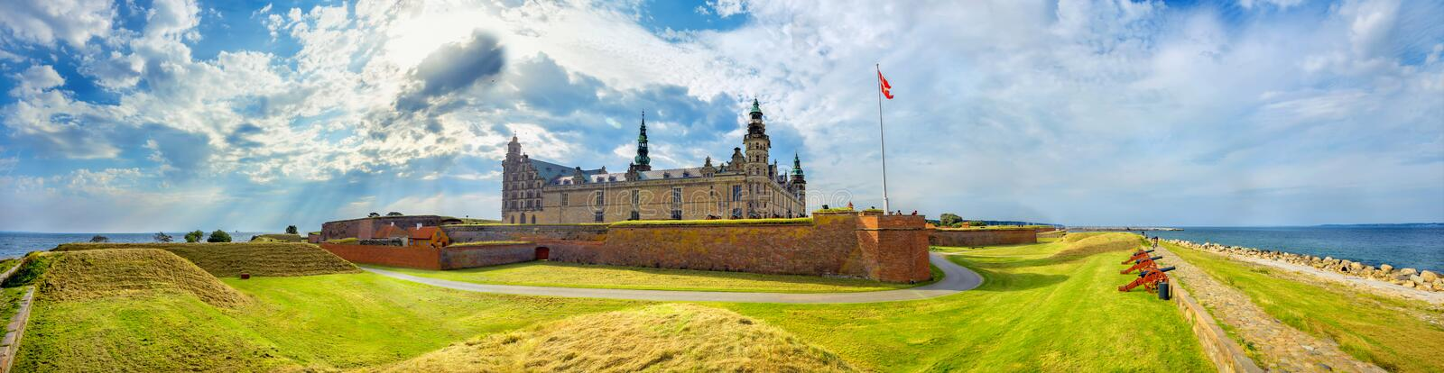 Fortifications with cannons and walls of fortress in Kronborg castle Castle of Hamlet. Helsingor, Denmark. Wide panoramic view of fortifications with defense stock image