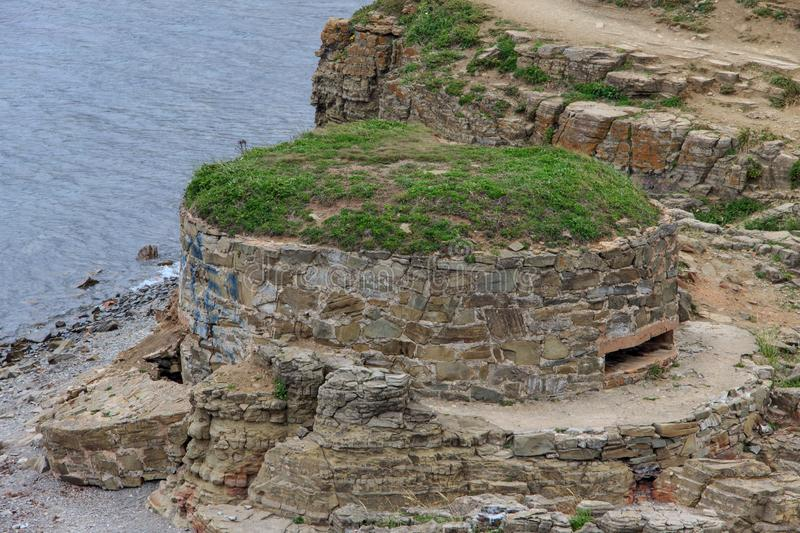 Fortifications of the Second World War DOT on Cape Tobisin Tobizin  Vladivostok. Fortifications of the Second World War DOT on Cape Tobisin Tobizin of the stock image